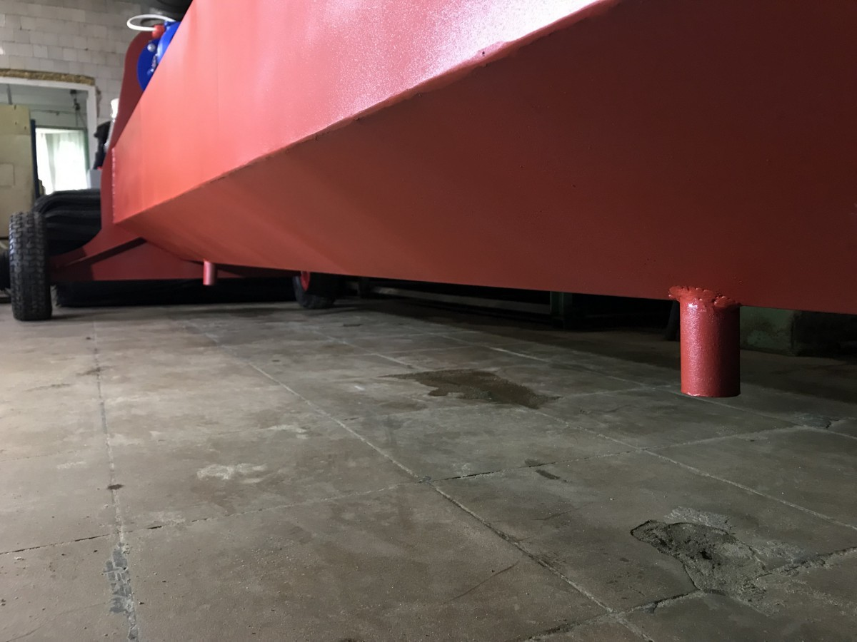 Сливной выход центрифуги для отжима ковров